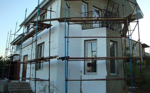 Як утеплити фасад будинку